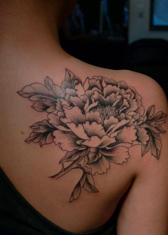 White and black flower tattoo
