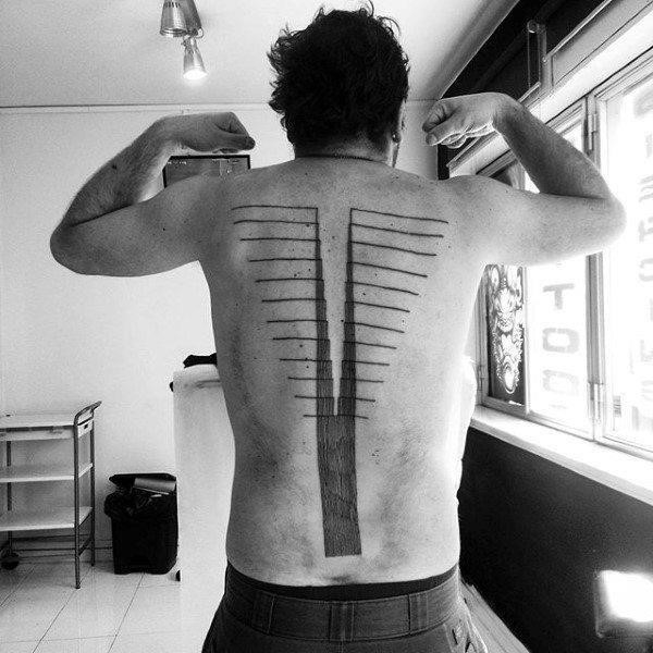 Abstract linework spinal cord tattoo