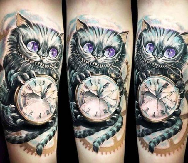 Artist  anjelika kartasheva  cheshire cat with clock tattoo 17169215756