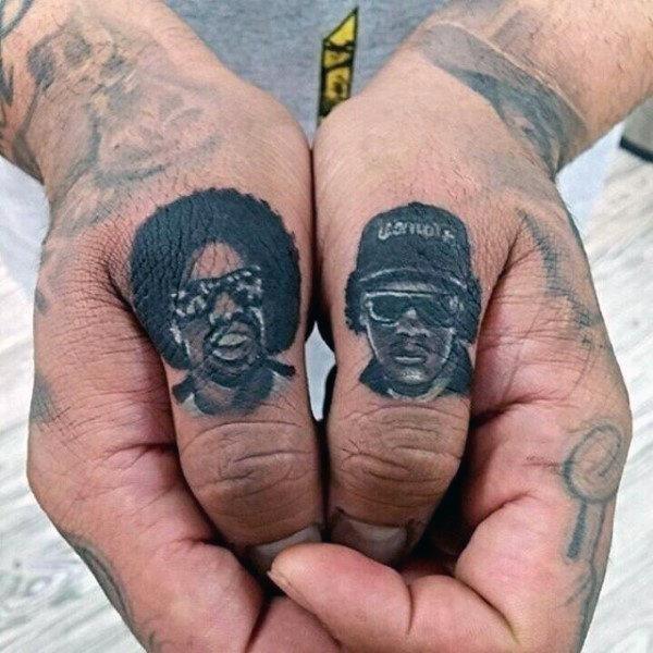 Artist portrait finger tattoos for men