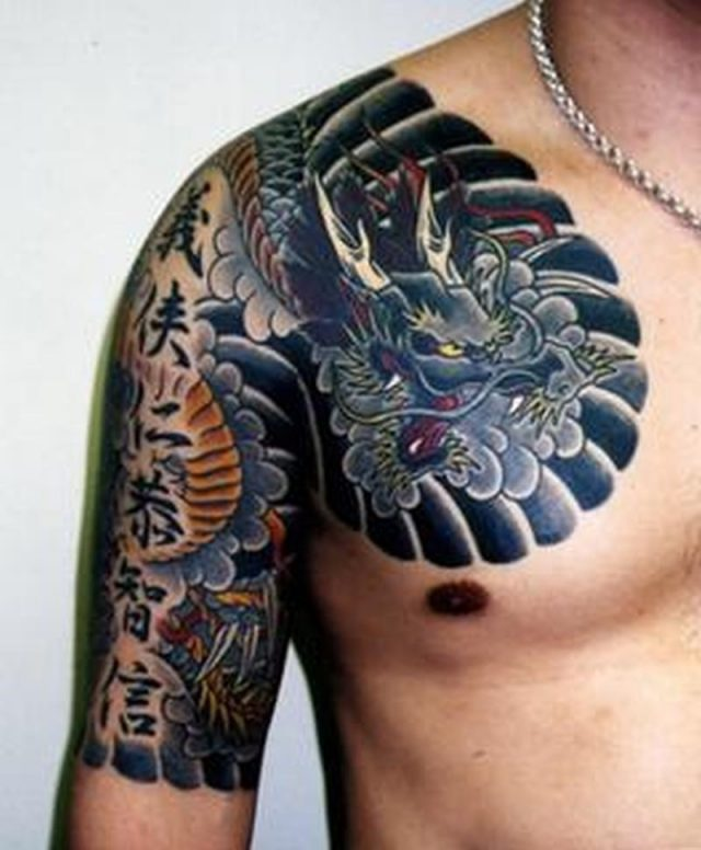 Attractive asian tattoo on chest arm
