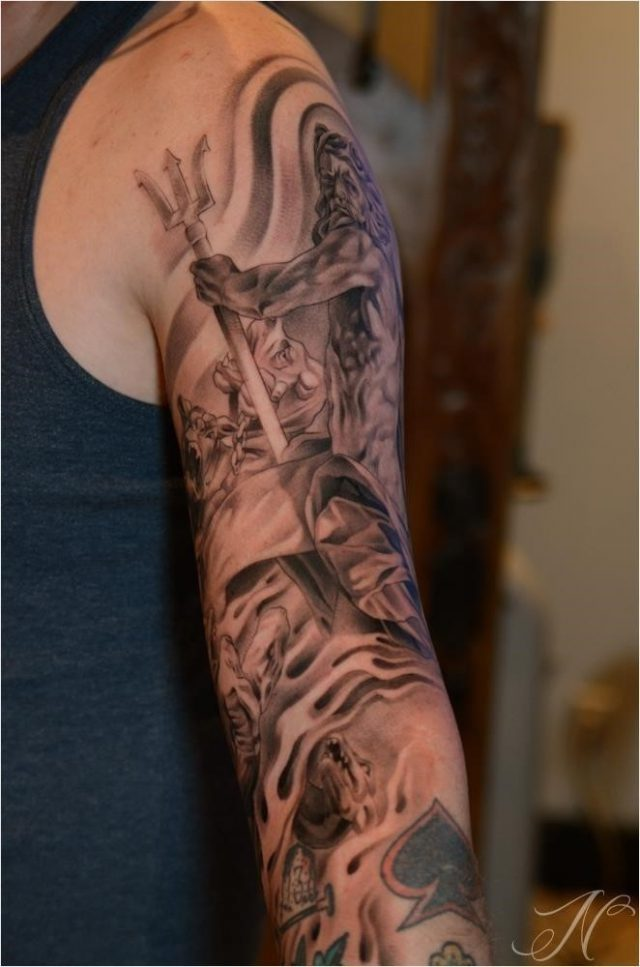 Awesome grey ink greek tattoo on man left sleeve