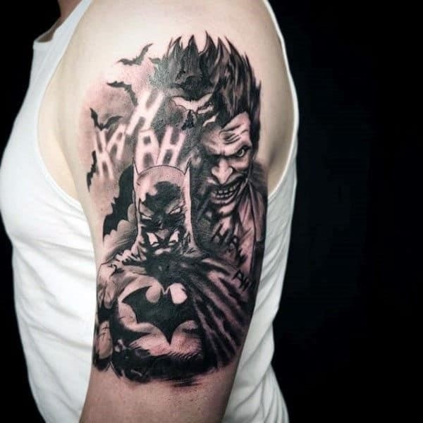 Batman and joker themed guys shaded black and grey ink arm tattoos
