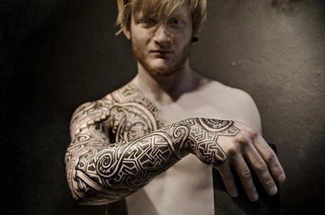 Beautiful grey ink viking tattoo on right sleeve