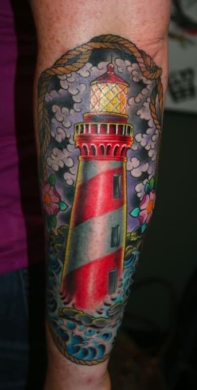 Best left leg color ink lighthouse tattoo