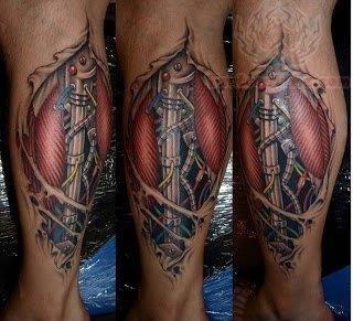 Bio mechanical color ink tattoo on leg