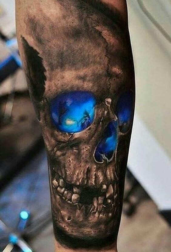 Black and deep blue skull tattoo on an arm