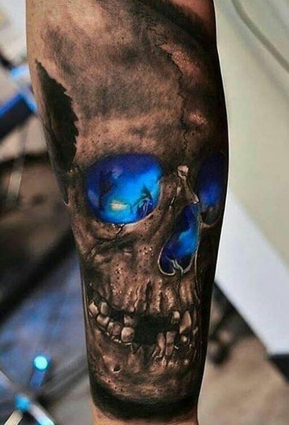 Black and deep blue skull tattoo on an arm