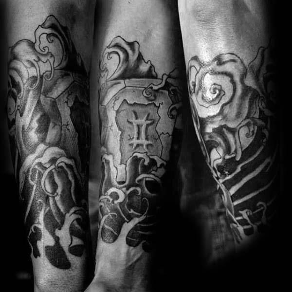Black and grey shaded guys forearm gemini tattoo ideas