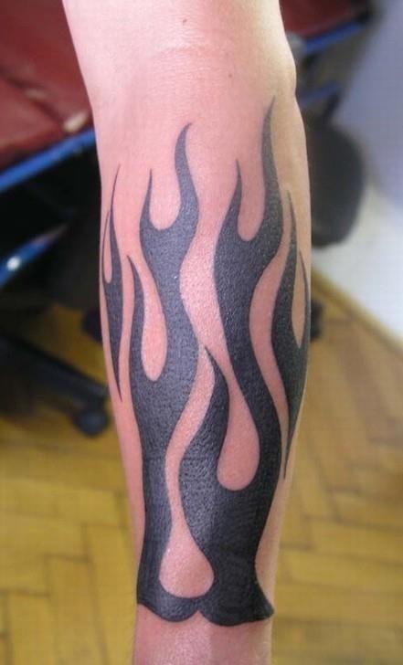 Black ink fire n flame tattoo on leg