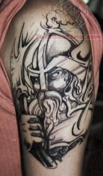 Black ink warrior tattoo on arm