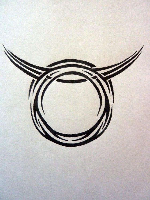 Black tribal taurus tattoo design