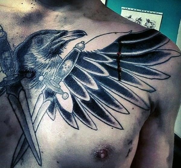 Bloody raven with crossed knives tattoo on chest for guys