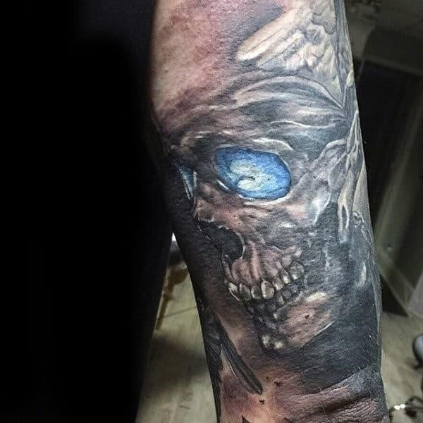 Blue eyed skull tattoo guys triceps