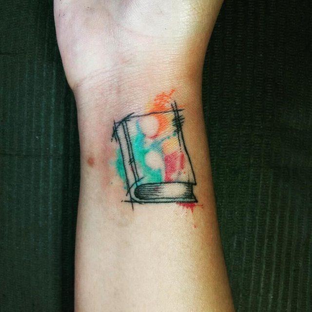 Book watercolor negative space semicolon tattoo