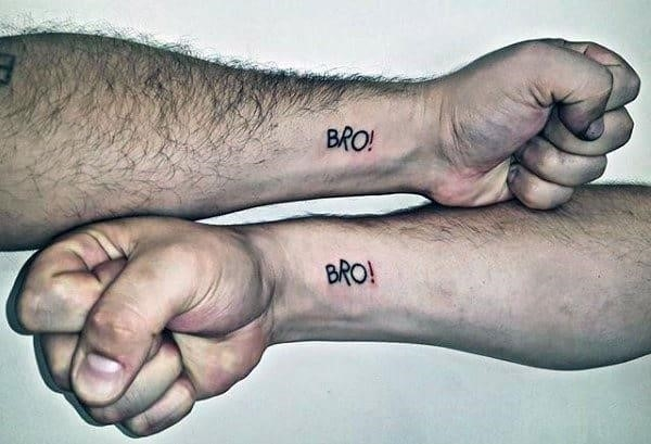 Bro exclamation point word tattoos on male brothers wrists