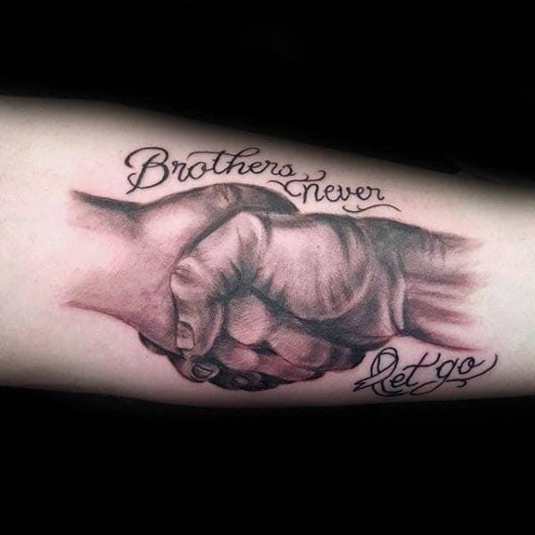 Brothers never let go memorial support hands holding male arm tattoos