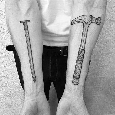 Carpenter tattoo on man