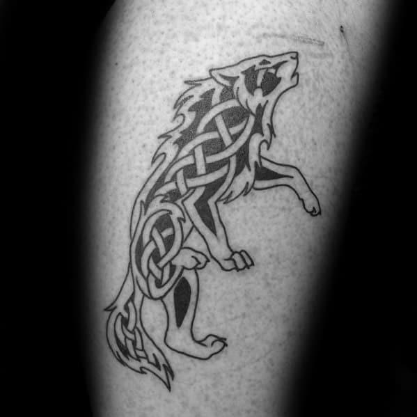 Celtic wolf tattoo design on man