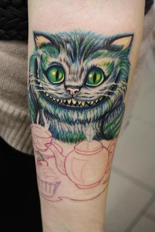 Cheshire cat tattoo on sleeve