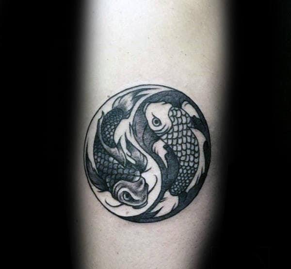 Circle pisces fish yin yang male forearm tattoos