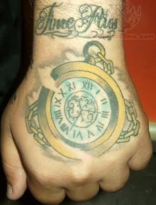 Clock tattoo on back hand