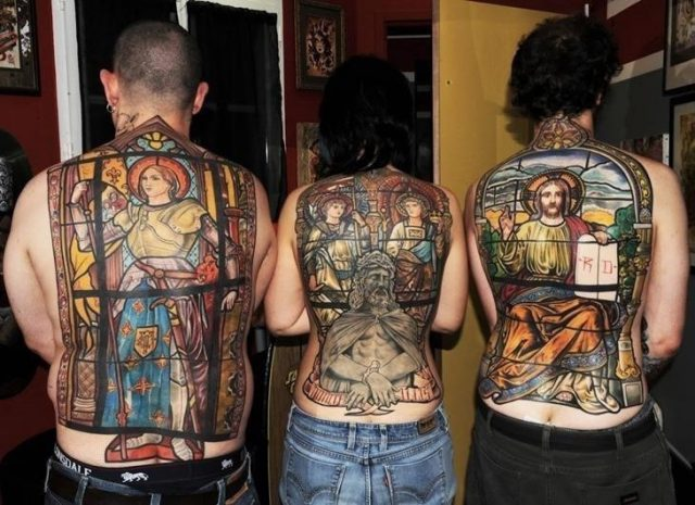 Colored back body christian tattoos for men
