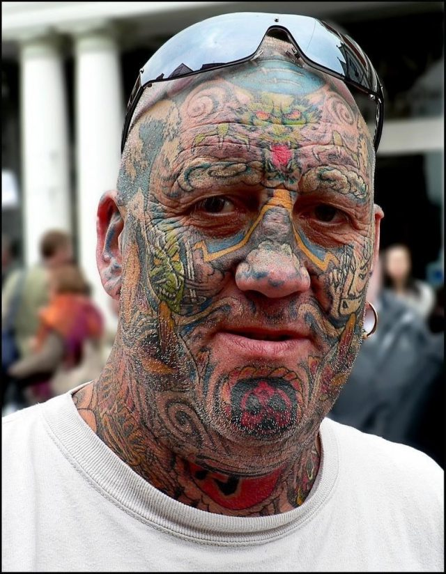 Colored crazy face tattoo