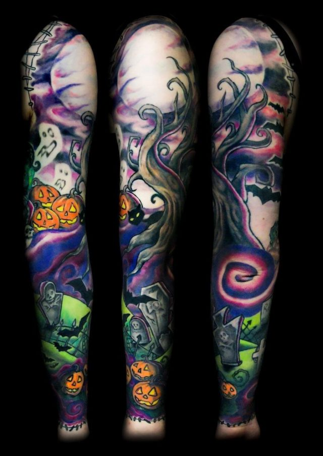 Colored halloween tattoo on full sleeve
