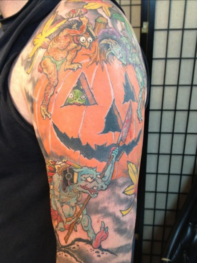 Colored halloween tattoo on left half sleeve