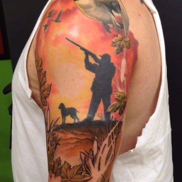Colored hunting scene tattoo