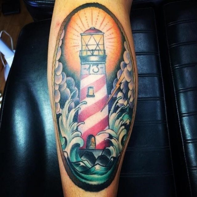 Colored lighthouse leg tattoo for men