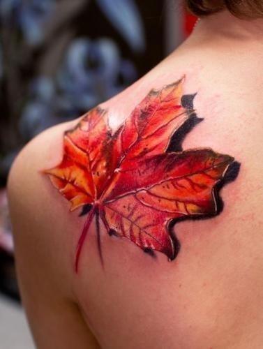 Colored maple leaf tattoo on left back shoulder