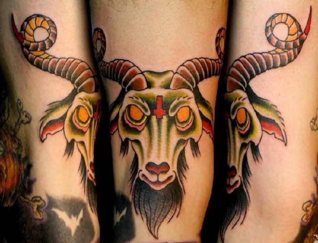 Colorful aries head tattoo