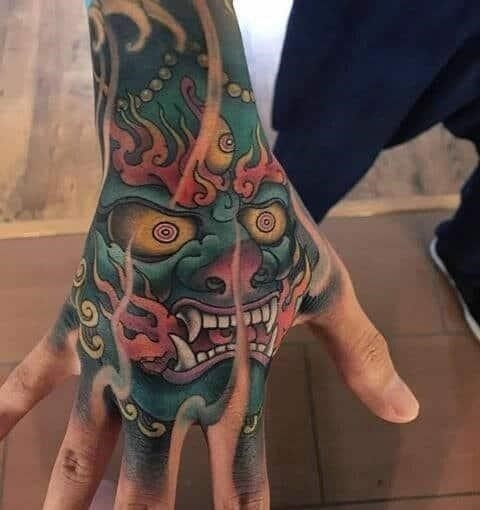 Colorful badass male hand tattoos