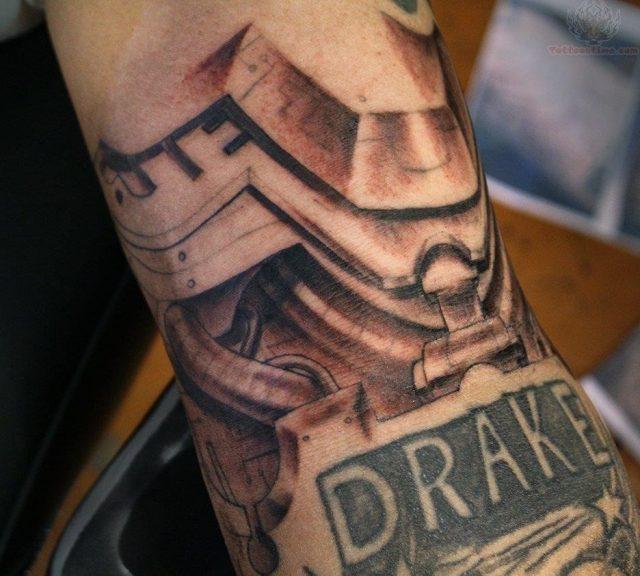 Drake mechanical tattoo