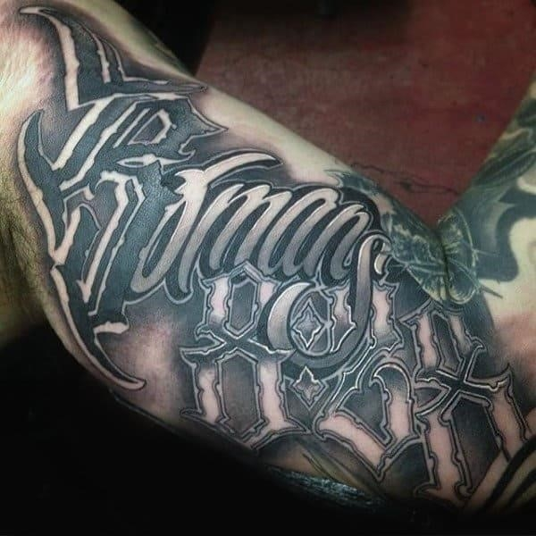 Fabulous lettering tattoo male forearms