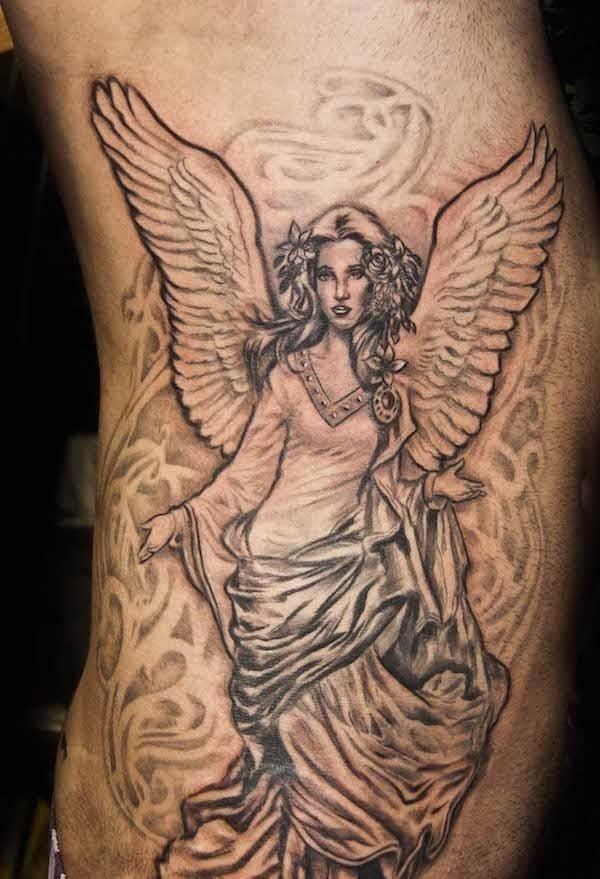 Female angel tattoo