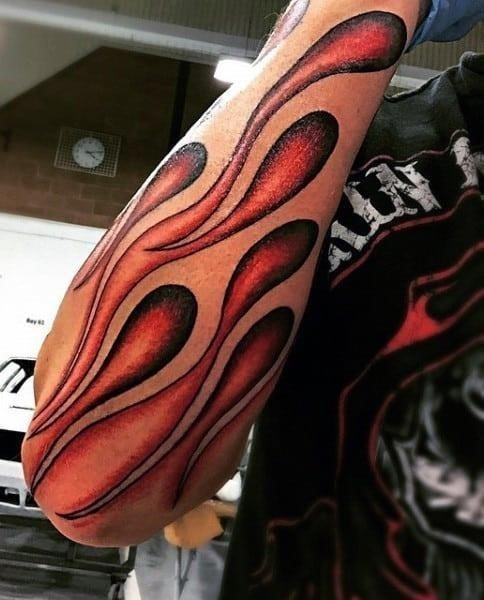 Flame tattoos on forearms for males