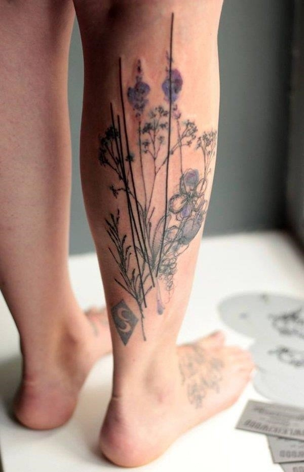 Floral leg tattoo for guys