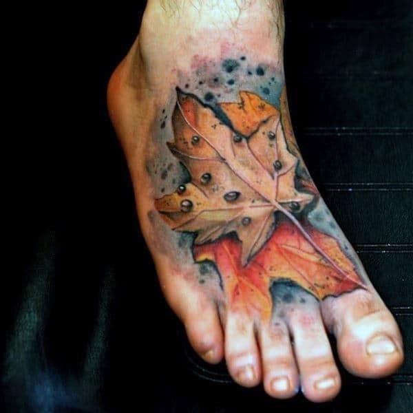 Foot tattoo of maple leaf on gentleman