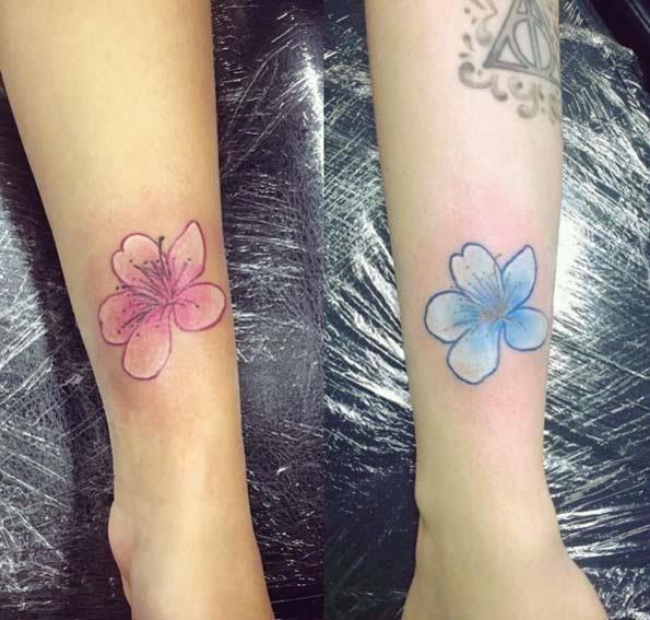 Foral sister tattoos