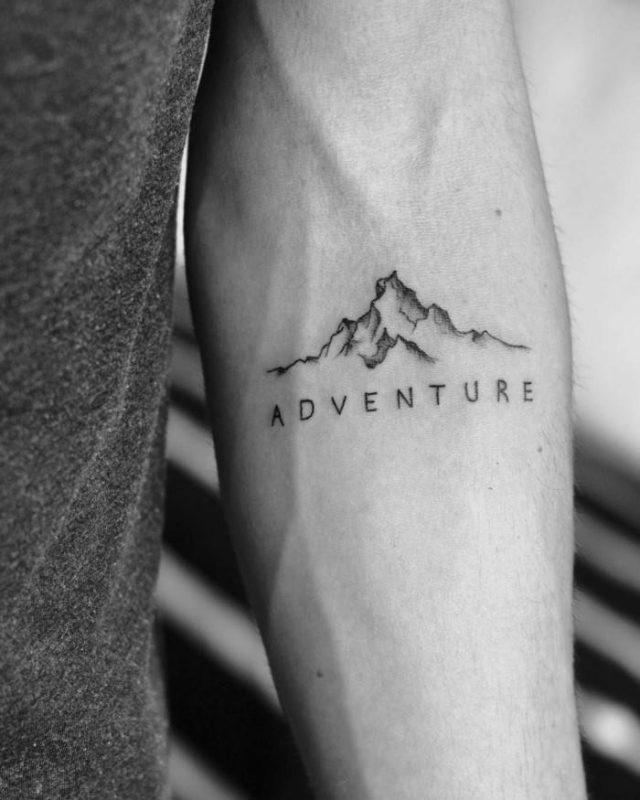 Forearm tattoo mountain tattoo sleeve minimalist mountain range adventure written under it