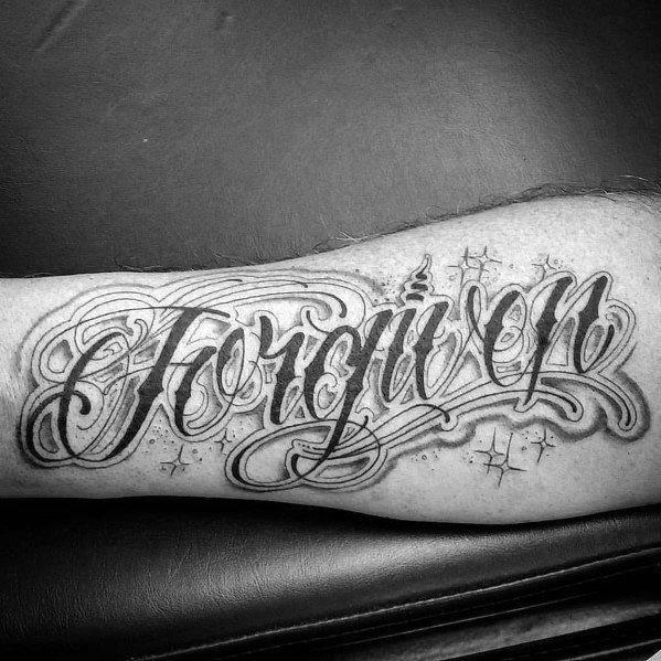 Forgiven decorative mens inner forearm tattoo