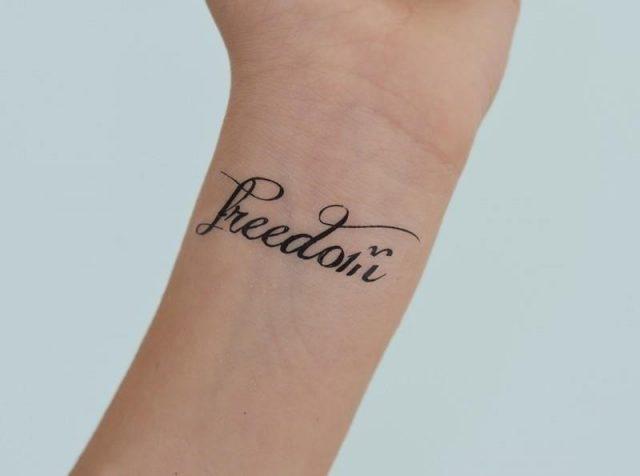 Freedom word wrist tattoo
