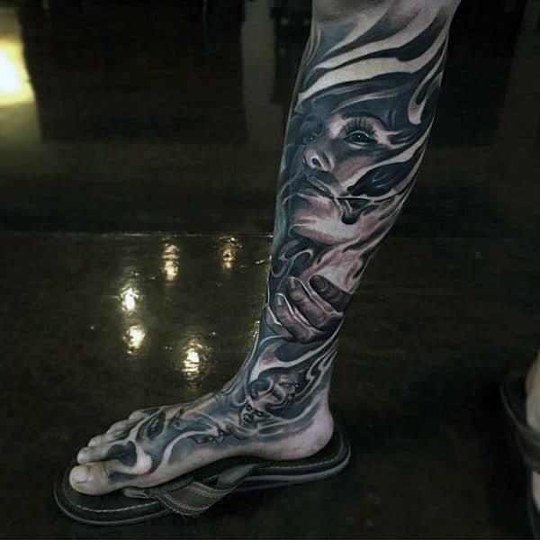 Full leg mens sleeve tattoo with black ink