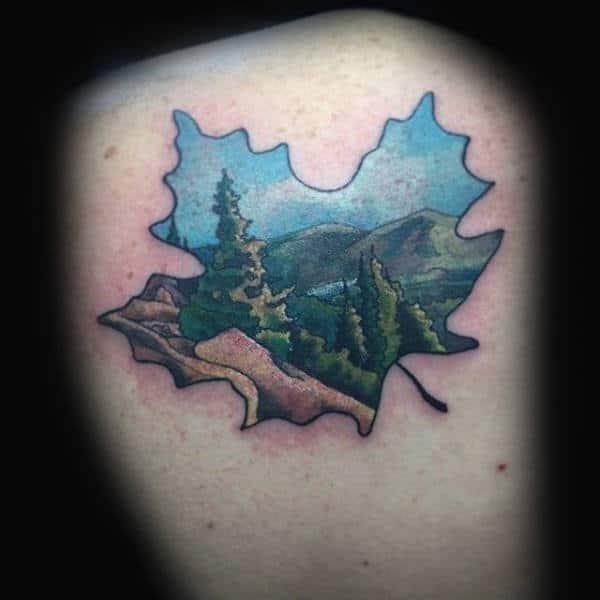 Gentleman with maple leaf nature landscape tattoo