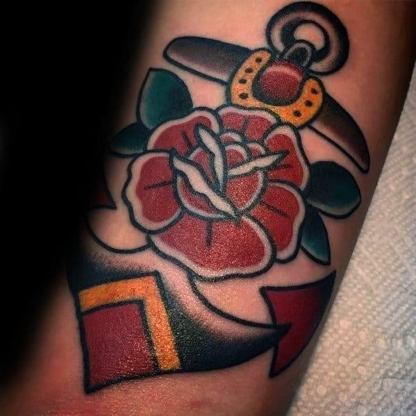 Gentleman with simple traditional rose flower anchor tattoo