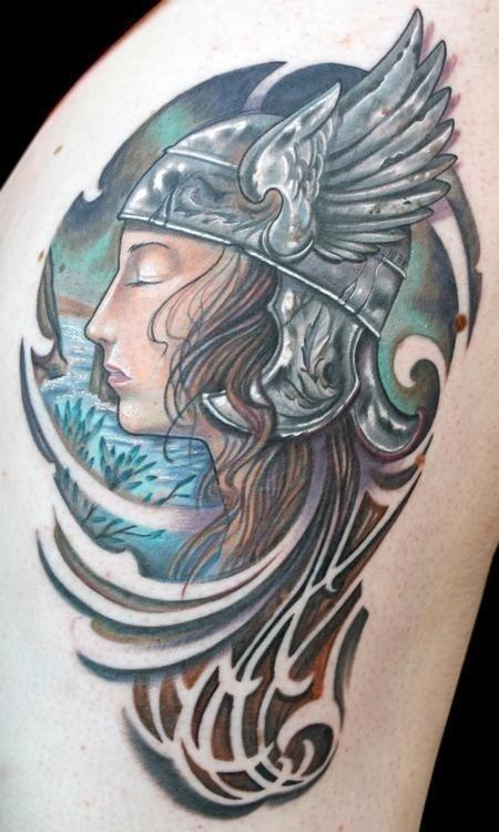 Girl face viking tattoo on left side rib