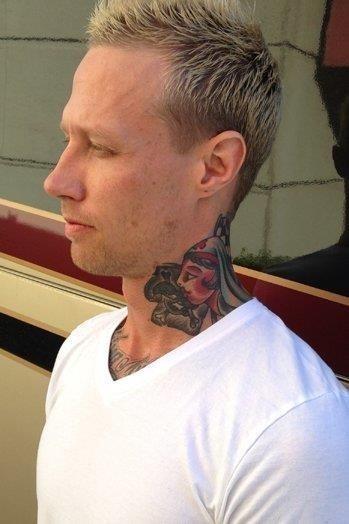 Girl head side neck tattoo